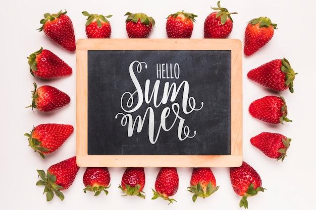Flat lay slate mockup with strawberries Free Psd