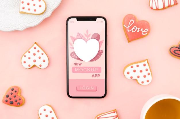 Mock-up di smartphone piatto con biscotti Psd Gratuite