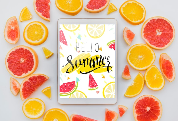 Flat lay summer background with tablet mockup Free Psd