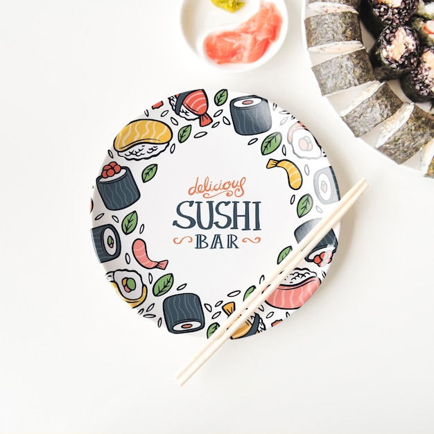 Flat lay of sushi plate and chopsticks on white background Free Psd
