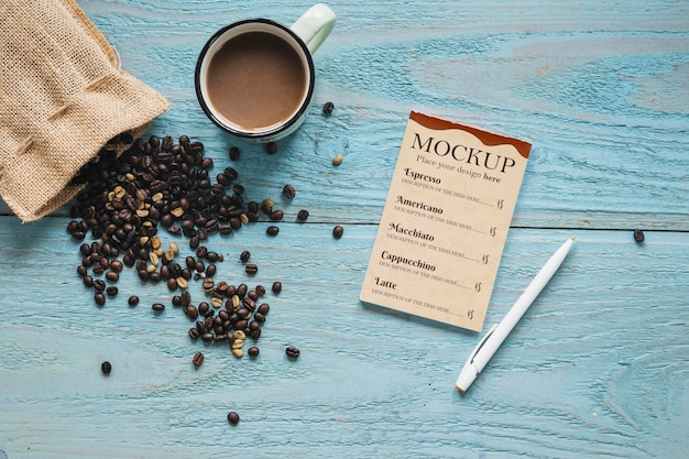 Flat lay textile bag filled with coffee beans Free Psd