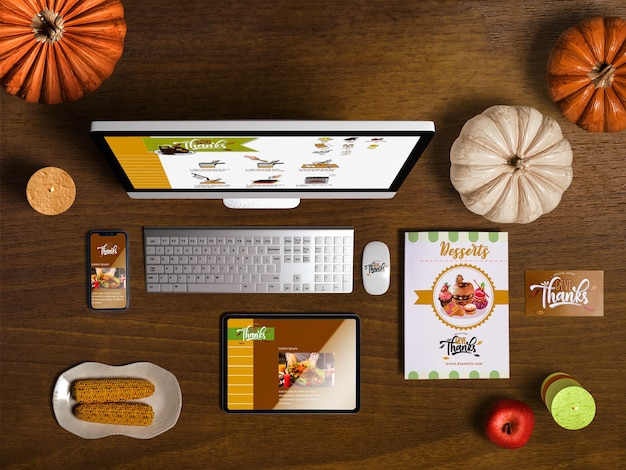 Flat lay of thanksgiving scene creator with wooden background Free Psd