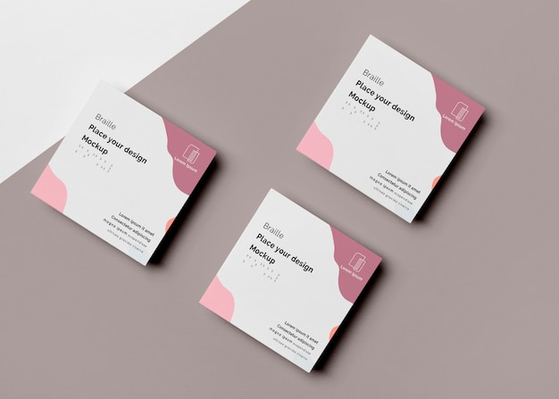 Flat lay of three business cards with braille design Free Psd