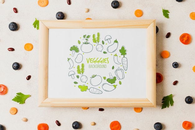 Flat lay vegetables assortment with frame mock-up Free Psd