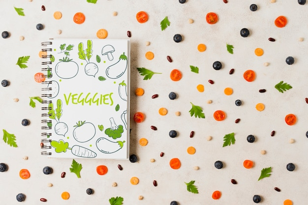Flat lay vegetables assortment with notebook mock-up Free Psd