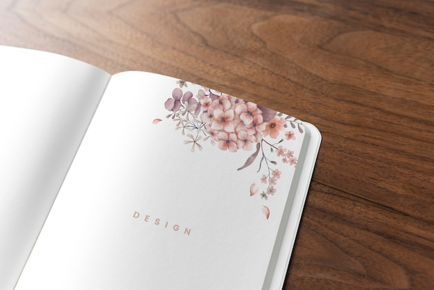 Floral notebook mockup on a wooden table Free Psd