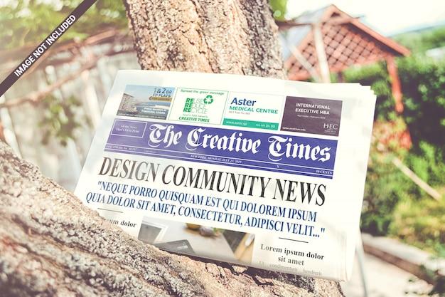 Folded newspaper on the tree mockup Premium Psd