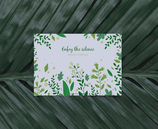 Foliage with inspirational message on card Free Psd