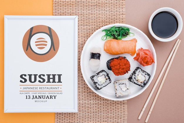 Frame beside plate with sushi rolls Free Psd