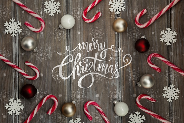Frame of candy cane with christmas message Free Psd