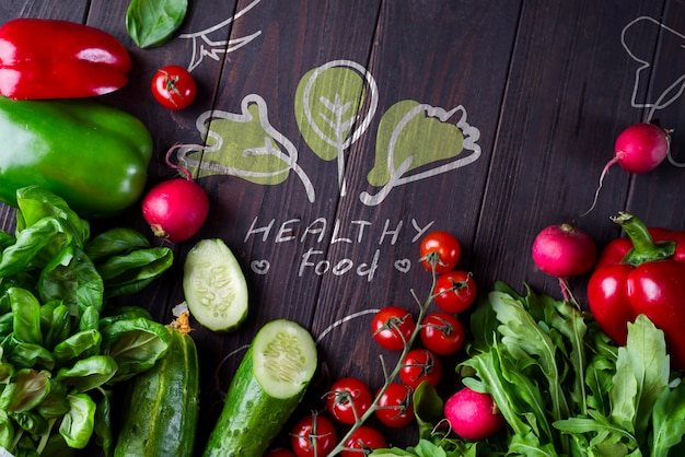 Frame of different health vegetables on a wooden background Premium Psd