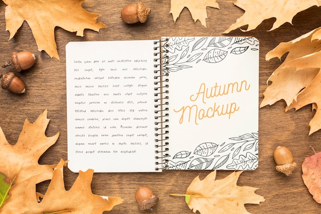 Frame of leaves with notebook Free Psd