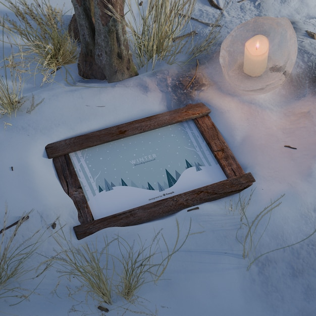 Frame lighted by candle on winter Free Psd