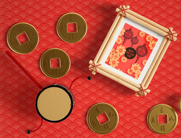 Frame mock up and chinese golden coins Free Psd
