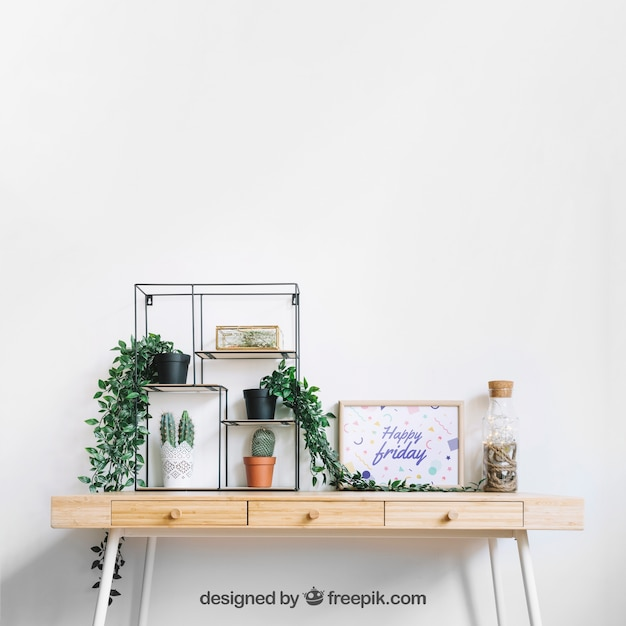 Frame mockup on decorated table Free Psd