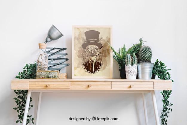 Frame mockup on decorative table Free Psd