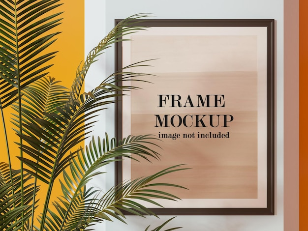 Frame mockup behind palm tree leaves Premium Psd