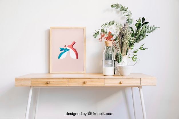 Frame mockup on table with flowers Premium Psd