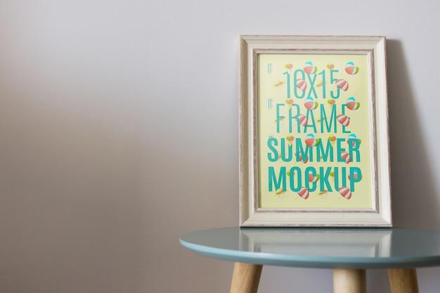 Frame mockup on table Free Psd