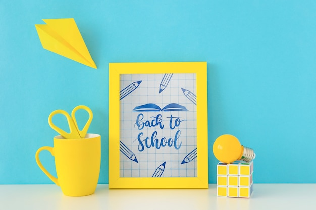 Frame mockup with back to school concept Free Psd