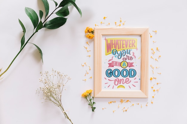 Frame mockup with floral decoration Free Psd