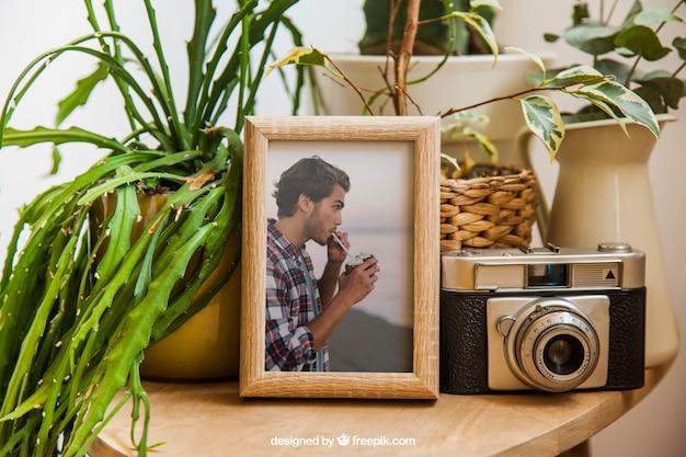 Frame mockup with flower pots Free Psd
