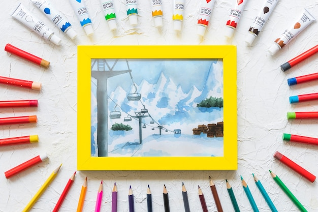Frame mockup with paint materials Free Psd