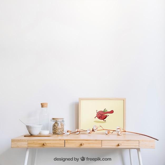 Frame mockup on wooden desk Free Psd