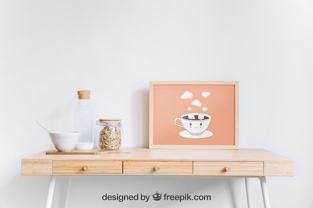 Frame mockup on wooden table Free Psd