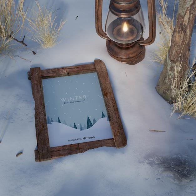 Frame on snow beside lantern Free Psd