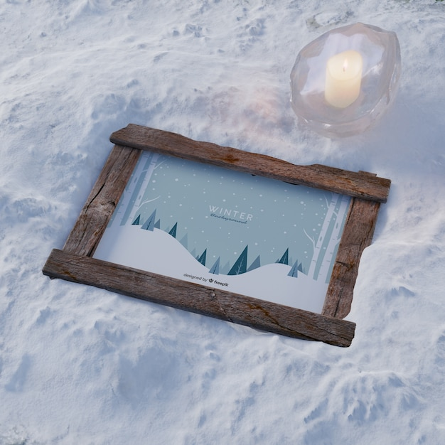 Frame on snow with frozen candle Free Psd