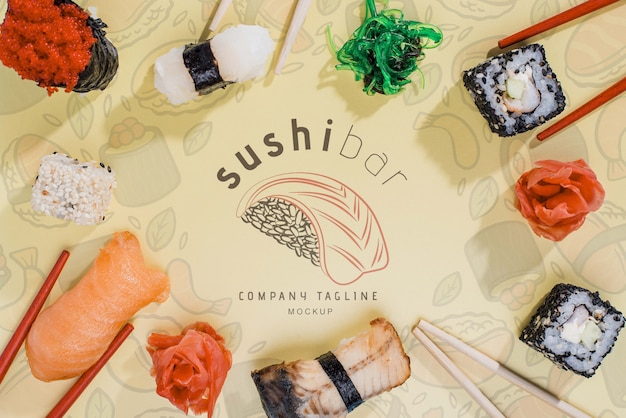 Frame of sushi rolls on table Free Psd