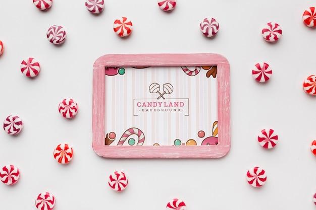 Рамка с конфетами рядом Бесплатные Psd