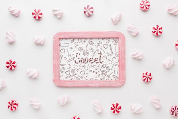 Рамка с вкусными конфетами рядом Бесплатные Psd