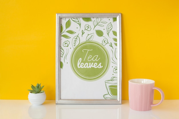 Frame with tea leaves concept Free Psd