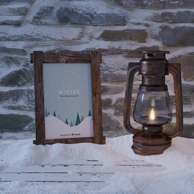 Frame with winter view beside lantern Free Psd