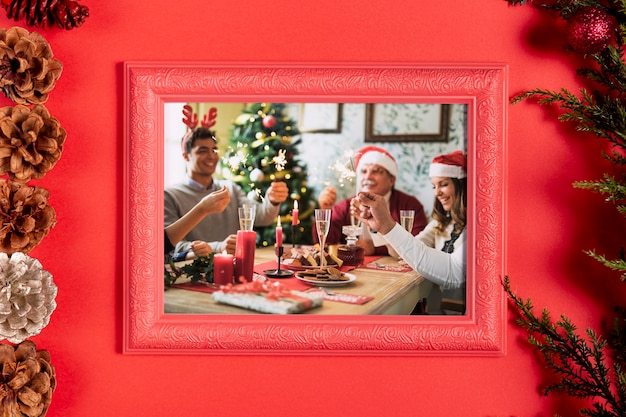 Framed family photo with pine cones Free Psd