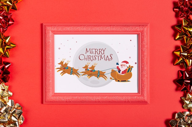 Framed santa and his reindeer photo with pull bows Free Psd