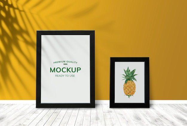 Frames by a yellow wall Premium Psd