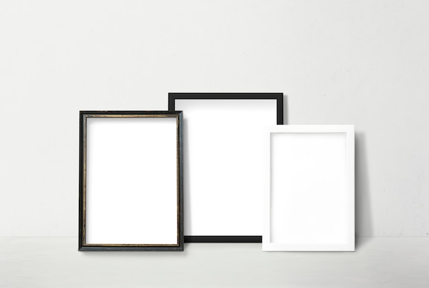 Frames leaning against a wall Free Psd