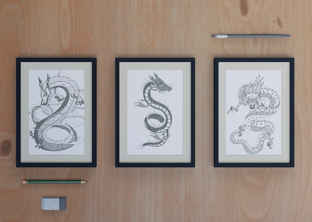Frames with snake sketch on sheet Free Psd