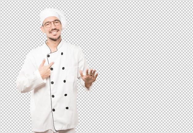 Дружелюбный молодой шеф-повар делает жест сохранять спокойствие Premium Psd