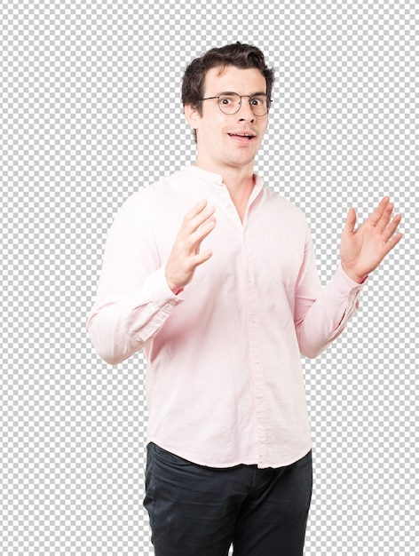 Friendly young man doing a gesture of admiration Premium Psd