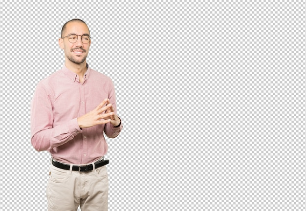 Friendly young man doing a gesture of confidence Premium Psd