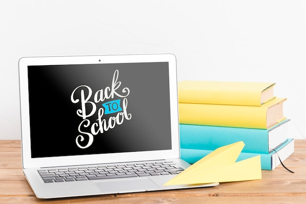 Front view back to school with laptop Free Psd