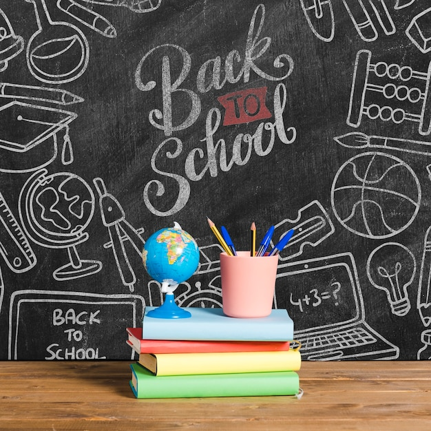 Front view back to school with pile of books Free Psd
