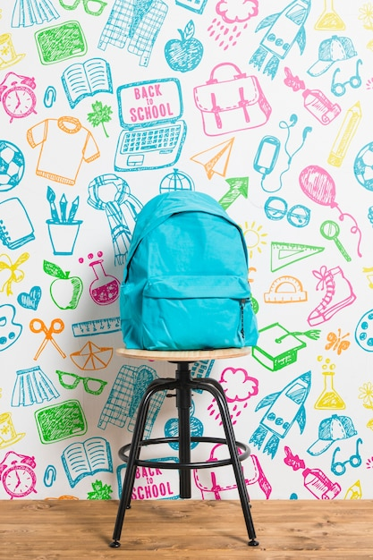 Front view backpack with colourful background Free Psd