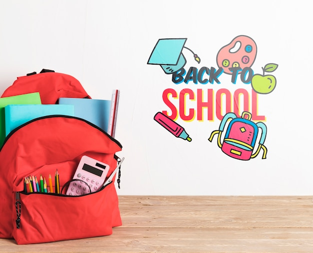Front view backpack with school supplies Free Psd