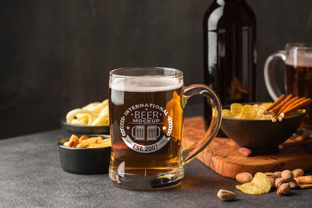 Front view of beer pint with assortment of snacks Free Psd