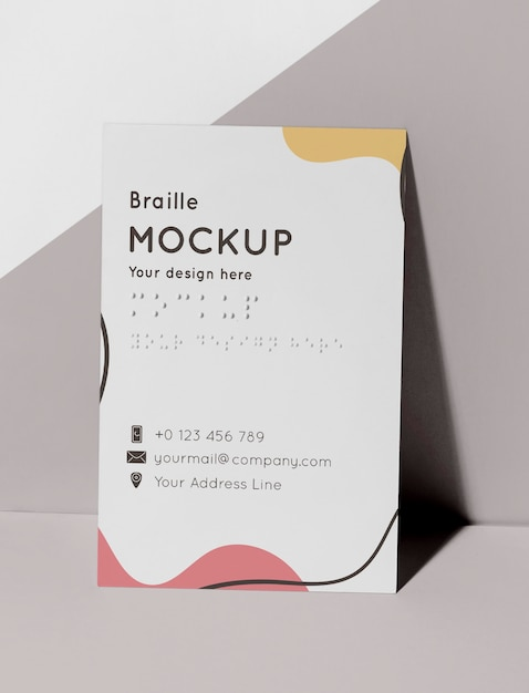 Front view of business card with embossed braille Free Psd
